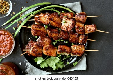 Pork kebabs, bbq meat on plate, top view.
