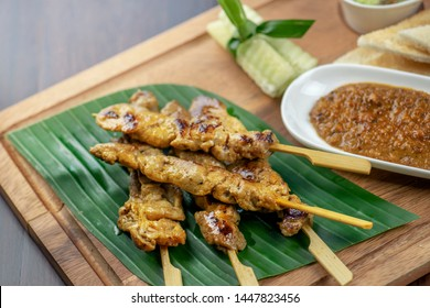 Pork kicks, grilled pork on banana leaf, grilled with dipping sauce and bread. Grilled skewered milk pork with dipping Sweet mashed bean sauce. Grilled skewer meat or pock are local Thai street food.