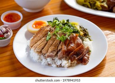 Pork Leg Strew or Khao Ka Moo  on wood table.Thai Cuisine