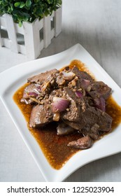 sautéed pork liver steak in ginger and fresh chopped onions