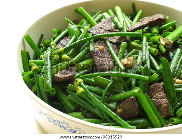 Pork Liver Stir Fried With Flowering Garlic Chives on white background
