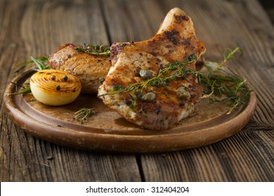 Pork loin fried on wooden table