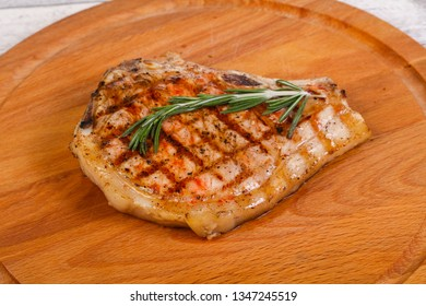 Pork loin with rosemary over the wooden board