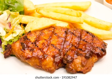 Pork loin steak in a dish Serve with French fries