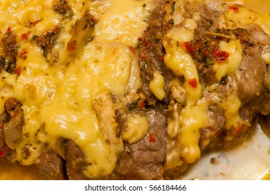pork meat baked with cheese