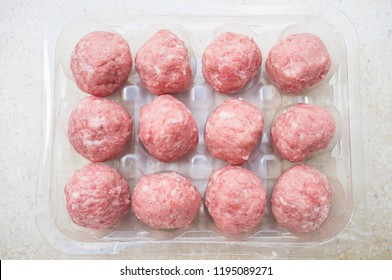 Pork meat balls in his package. Overhead view