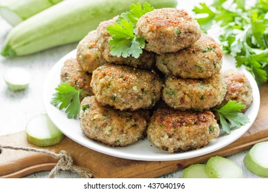 Pork meat cutlets with zucchini and parsley