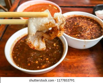 "Pork and meat  dipping to chilli spicy sauce of Thai traditional spicy shabu shabu hot pot, dipping meat in boiled spicy soup, Thai North-Eastern Food thai people call ""Jaiew Hon""."