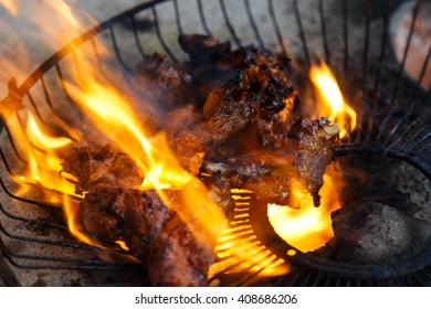 pork meat roasting on fire closeup