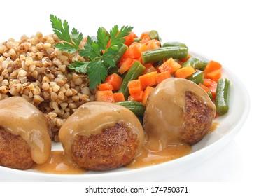 Pork meatballs with sauce, buckwheat, green beans and carrots