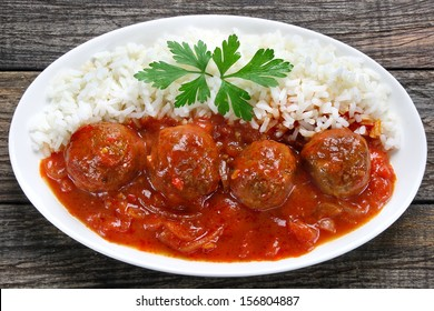 Pork meatballs in tomato sauce with rice