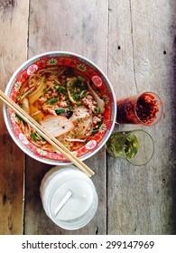 Pork noodle on wooden background