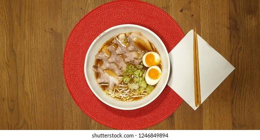 pork ramen soup in a white bowl
