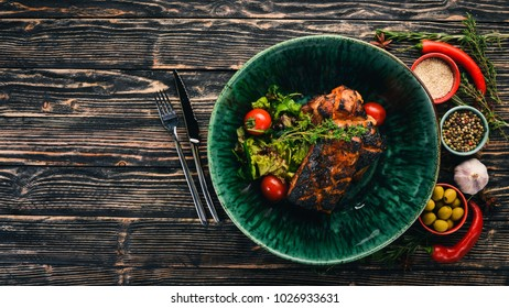 Pork ribs baked in hosper. Meat. Top view. On a black wooden background. Copy space.