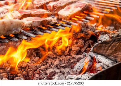 pork ribs on a grill over a wood fire