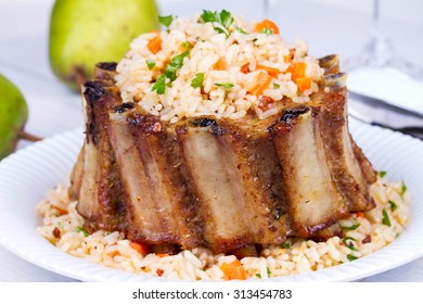 Pork Ribs With Rice, Carrot, Paprika Pepper And Parsley