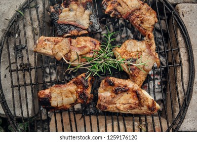 Pork ribs with rosemary on the grill from above