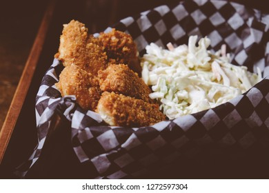 pork rind encrusted chicken tenders with home made cole slaw