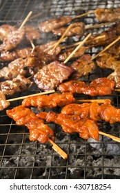 Pork roasted chicken skewers on the stove. In the market. Thailand is a style of food in times of urgency.