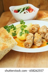 Pork rolls with potatoes and vegetable salad.