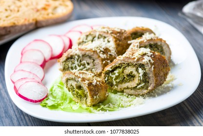 pork roulades stuffed with spinach sprinkled with freshly grated horseradish served with lettuce and radish