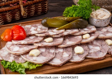 Pork saltison on a wooden board. Delicious pork snack. Closeup