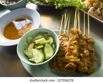 pork satay and side dishes