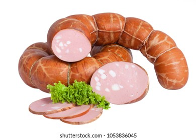 Pork sausage with pieces of fat. Whole and partially sliced product. Decorated with lettuce. Isolated on white background