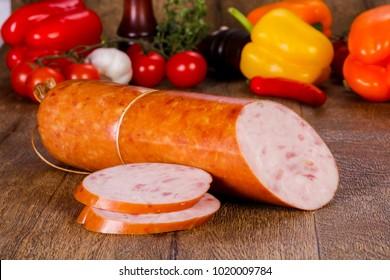 Pork sausages over wooden background