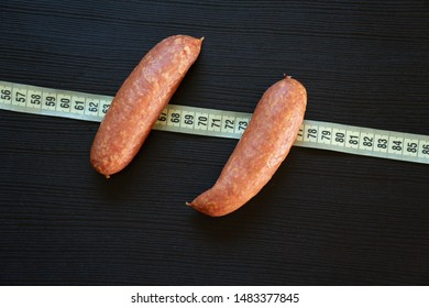 Pork sausages wrapped in measuring tape. Diet concept.