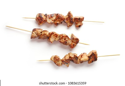 Pork shish kebab isolated on white background, top view
