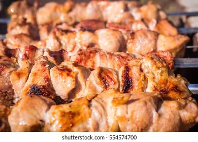 Pork shish kebab on skewers roasted on grill