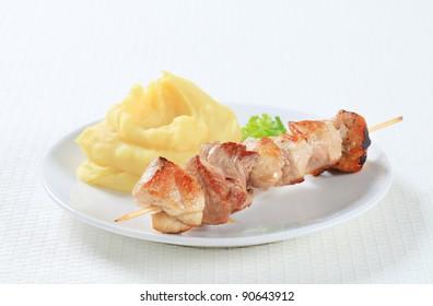 Pork skewer and mashed potato