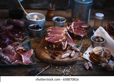 Pork spanish lomo sandwich. Spanish tapas with cured lomo and jamon.