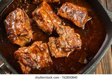 Pork spare ribs on dish in own sauce. Ready for eat