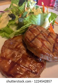 Pork steak. Grilled steaks, Mashed potatoes, Toast and vegetable salad. Atmosphere in the restaurant. Having lunch together among friends. Calorie diet And high in protein.