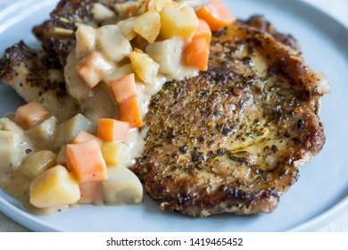 pork steak with potato, sweet potato and carrot sauce
