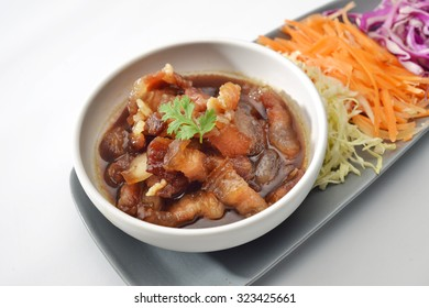 Pork sweet stewed in the sweet brown gravy, Chinese-Thai cuisine on grey background