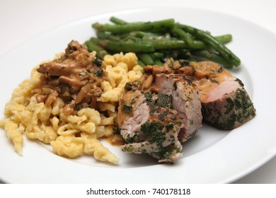 Pork tenderloin with spaetzle and beans