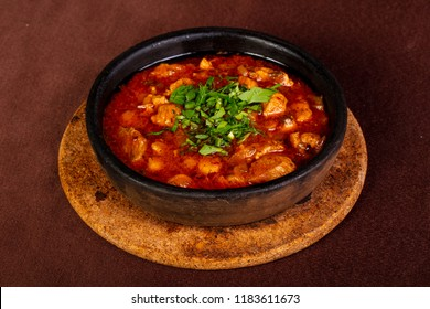 Pork with tomato sauce in the pan