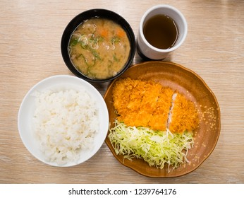 Pork Tonkatsu set - Japanese food, Set of deep fried pork cutlet coated with flaky panko bread crumb over shredded cabbage served with rice and Miso soup.