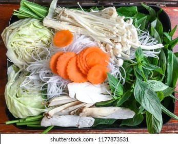 """Pork,Meat,Carrot,Mushroom,Bacon and vegetable in tray of Thai traditional spicy shabu shabu hot pot, dipping meat in boiled spicy sauce, Thai North-Eastern Food thai people call """"Jaiew Hon""""."""