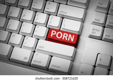 Porn typing on the white keyboard. Online porn concept