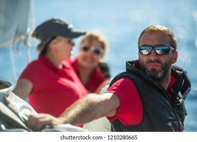POROS, GREECE - OCT 9, 2018: Sailors participate in sailing regatta 20th Ellada Autumn 2018 among Greek island group in the Aegean Sea, in Cyclades and Saronic Gulf.