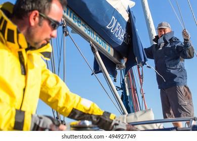POROS, GREECE - SEP 29, 2016: Sailors participate in sailing regatta 16th Ellada Autumn 2016 among Greek island group in the Aegean Sea, in Cyclades and Saronic Gulf.