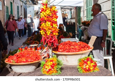 Porreres, Mallorca, Spain - October 27, 2019: Sun-dried cherry tomatoes and pepper bouquets for sale on Porreres Market. Porreres, Majorca, Spain