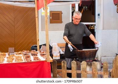 Porreres, Mallorca, Spain - October 27, 2019: Man cooking almond nougat for sale on Porreres Market. Majorca, Spain