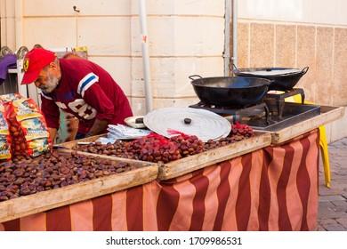 Porreres, Mallorca, Spain - October 27, 2019: Roasted chestnuts for sale on Porreres Market. Majorca, Spain