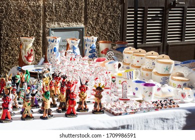 Porreres, Mallorca, Spain - October 27, 2019: Siurells, typical Majorcan hand painted clay figures with a whistle, for sale on Porreres Market. Majorca, Spain