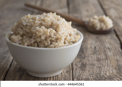 Porridge crushed wheat on a wooden background